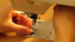 how to change the presser foot of a sewing machine with a snap