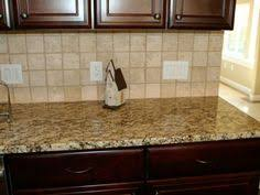backsplash with gold granite countertop here are santa cecilia