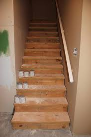 hmmm painted stairs in the basement to match the black ceiling