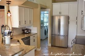 white countertop on kitchen cabinet with white gas stove with