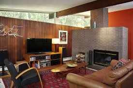 mid century modern living room with fireplace window treatments