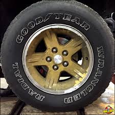 wk xk wheel tire picture goodyear wrangler tire mounted on gold painted wheels under a