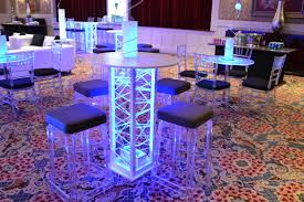 club theme bar mitzvah event decor glowing cocktail tables blue