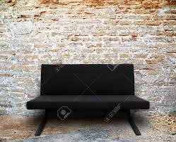 modern sofa in old brick wall room setting stock photo picture