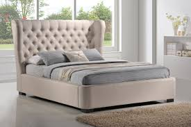 bedroom nail head trim upholstered headboard with glass windows