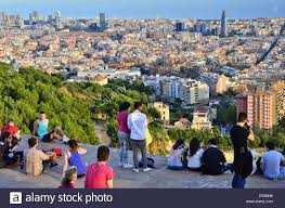 barcelona city view young people enjoying evening view over city of barcelona from