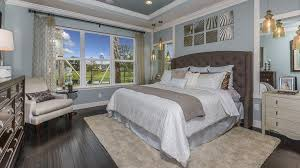 contemporary master bedroom with crown molding handscraped wood