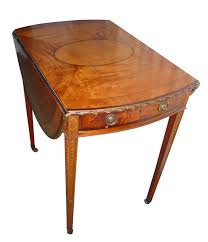 a fine inlaid satinwood pembroke table in antique drawing room