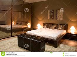 Bedroom With Furniture Interior Of Modern Bedroom With Mirrors Royalty Free Stock Photos