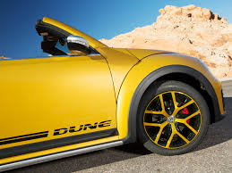 yellow volkswagen convertible vw u0027s dune beetle is a city car raring for a road trip wired