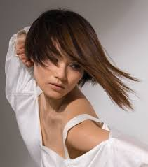 asian hair model sporting a bob hairstyle with a long strand