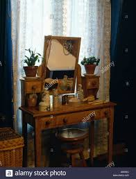 interiors bedrooms dressing tables curtains stock photos