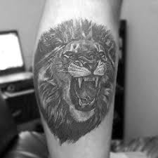 30 lion leg tattoo designs for men big cat ink ideas