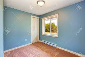 exquisite empty small room light blue walls and brown carpet floor