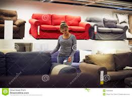 young home decor woman shopping for furniture and home decor stock photo image
