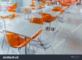 modern drink table orange plastic chairs white table on stock photo 474172285
