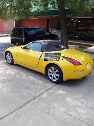 nissan 350z yellow convertible automobile