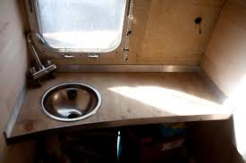 spacefarm renovating airstream bathroom sink and counter