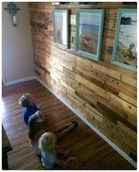 Laminate Flooring On A Wall How To Decorate A Wood Pallet Wall With A Photo Display
