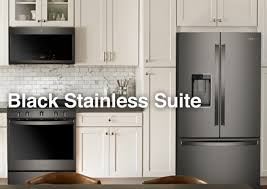 white kitchen cabinets and black stainless steel appliances whirlpool introduces fingerprint resistant black stainless