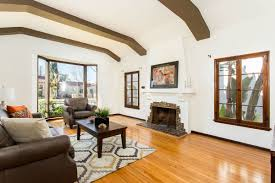 dreamy spanish style house with exposed beams in leimert park asks