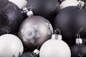 black white and taupe coloured christmas decorations ornaments