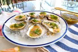 mignonette cuisine oysters on the half shell with pink grapefruit sriracha mignonette