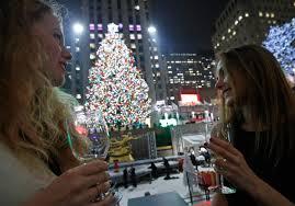 photos rockefeller center christmas tree lights up newsradio wina