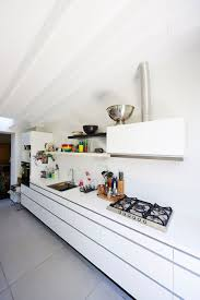 snazzy contemporary extension transforms beautiful brussels home view gallery all white kitchen workstation with hint black