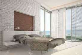 modern design bedroom with floor ceiling windows and seascape