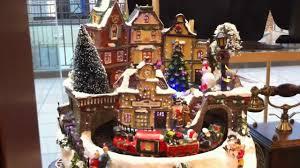 beautiful fiber optic christmas village scene with moving santa