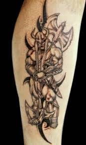 warrior viking with axe tattoo on biceps in 2017 real photo