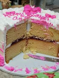 edible delights vanilla cake w edible flowers and raspberry filling picture of