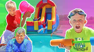 giant backyard water slide into the pool for kids surprise toys