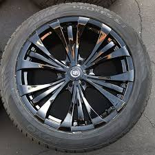 cadillac escalade black rims 22 cadillac escalade by vogue wheels 22 inch gloss black rims toyo