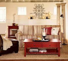 classy red accent on wooden coffe table above small brown carpet