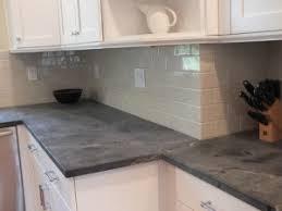 Black Soapstone Kitchen With White Subway Tile Backsplash - Soapstone backsplash