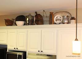 how to decorate top of kitchen cabinets ideas decorating above kitchen cabinets decor amys office