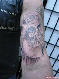 jesus tattoo on man left inner bicep tattoo viewer com