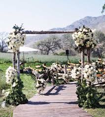 wedding arches made of tree branches winter wedding ideas birch bark details branch décor inside