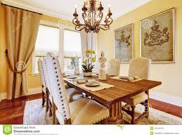 luxury dining room with carved wood table stock photo image