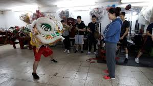 lion dancer book in new york s lunar new year parade women are breaking barriers