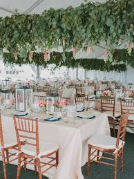 whimsical outdoor wedding tent with hanging silver dollar