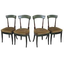 set of four empire painted wood dining chairs upholstered seats