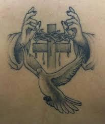 cross hands tattoo