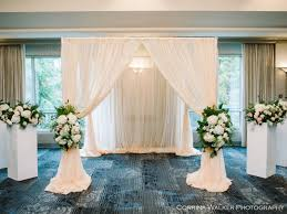 wedding arches calgary fiori con ceremony arches arrangements and pew bows