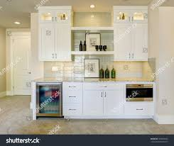 wet bar white cabinets fitted glass stock photo 704942833