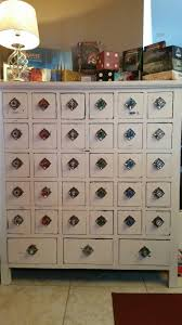 i turned an old apothecary cabinet into mtg storage a great way