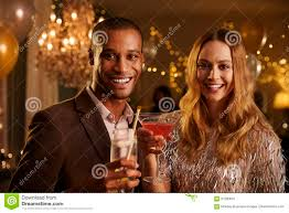 portrait of couple with drinks enjoying cocktail party stock photo