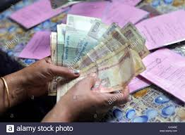 indian rupees and saving books of a micro finance loan self help